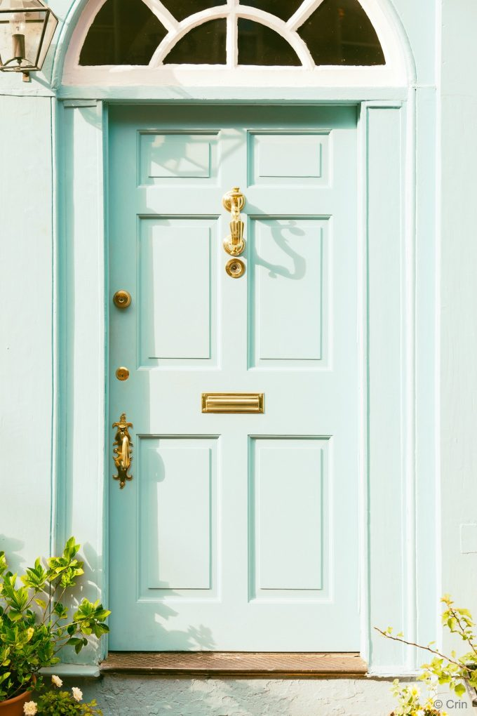 Mint Green Front Door with Gold Hardware - photo by Crin