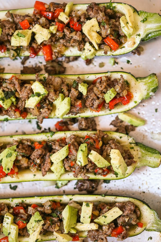 Stuffed Zucchini Recipe - made with spiced ground beef and topped with avocado!