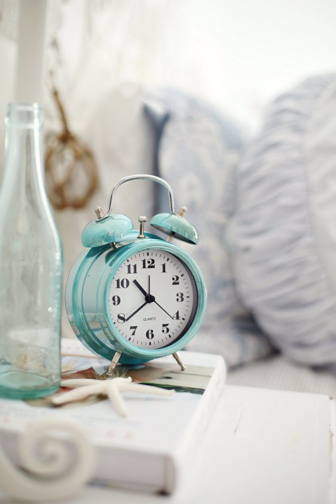 bedside alarm clock - photo by A Beach Cottage