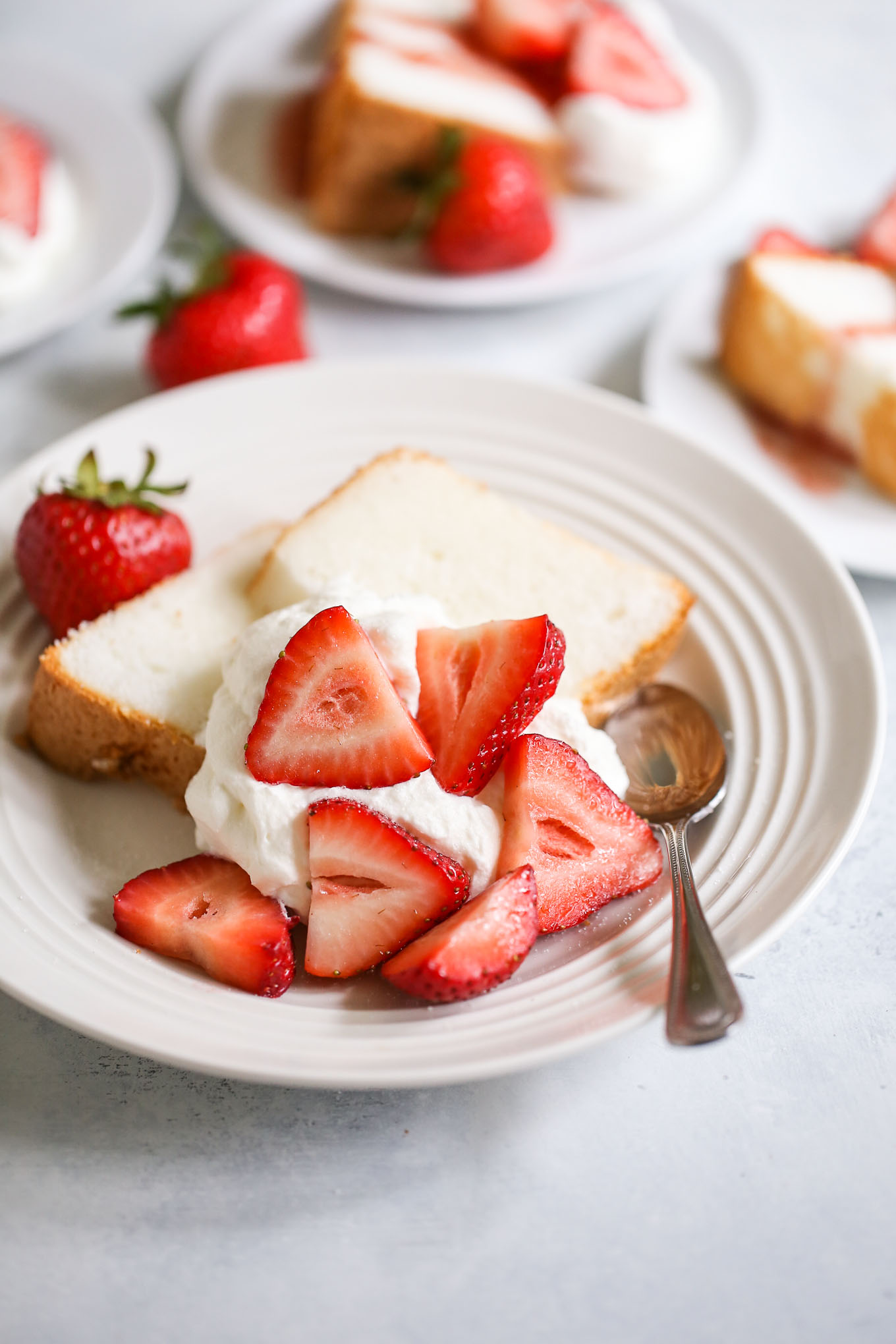 Strawberry shortcakes made with angel food cake, fresh strawberries, and whipped cream