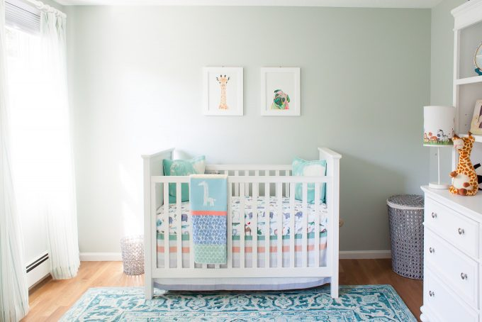 baby boy nursery with white furniture and cool blue green details