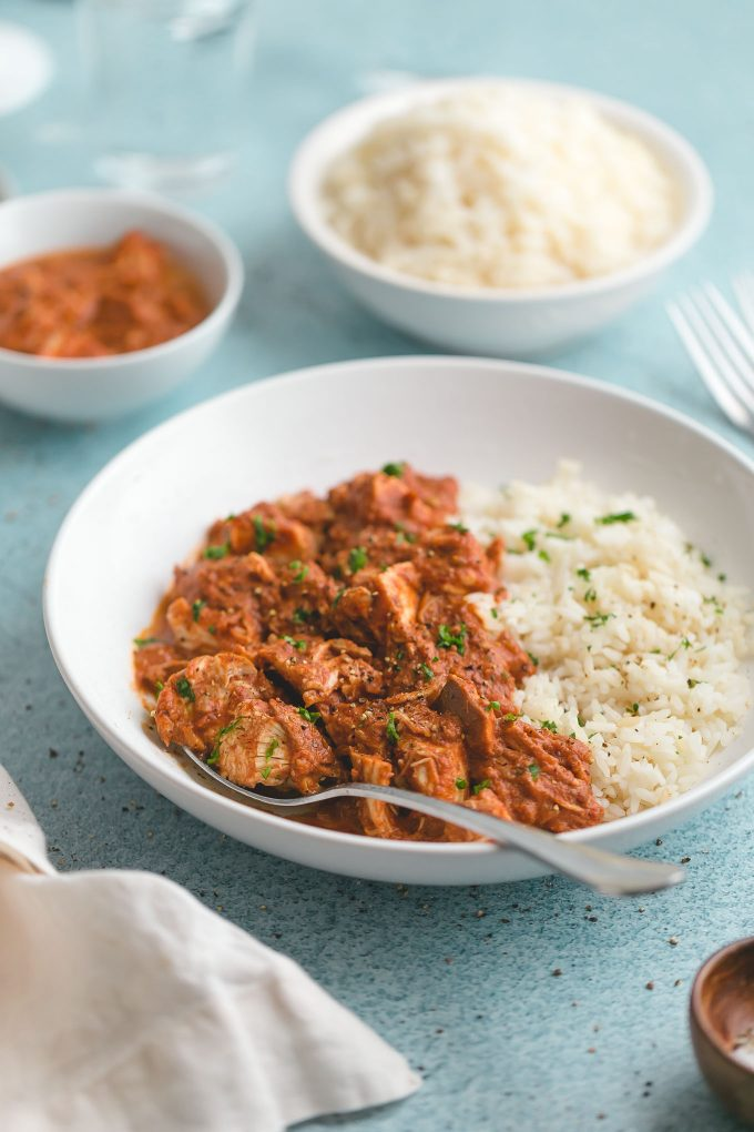 Slow Cooker Chicken Tikka Masala - all the big, bold flavor of the traditional dish, but it's far easier—and lighter, too (263 calories or 3 Weight Watchers points). The chicken is fall-apart tender in a deliciously creamy, fragrant, slightly sweet, and subtlety tangy tomato sauce.