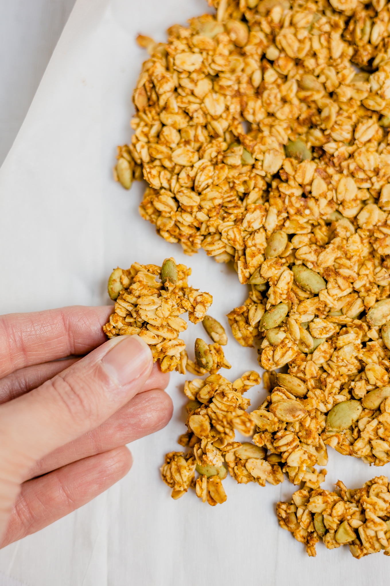 overhead shot of granola on a baking tray