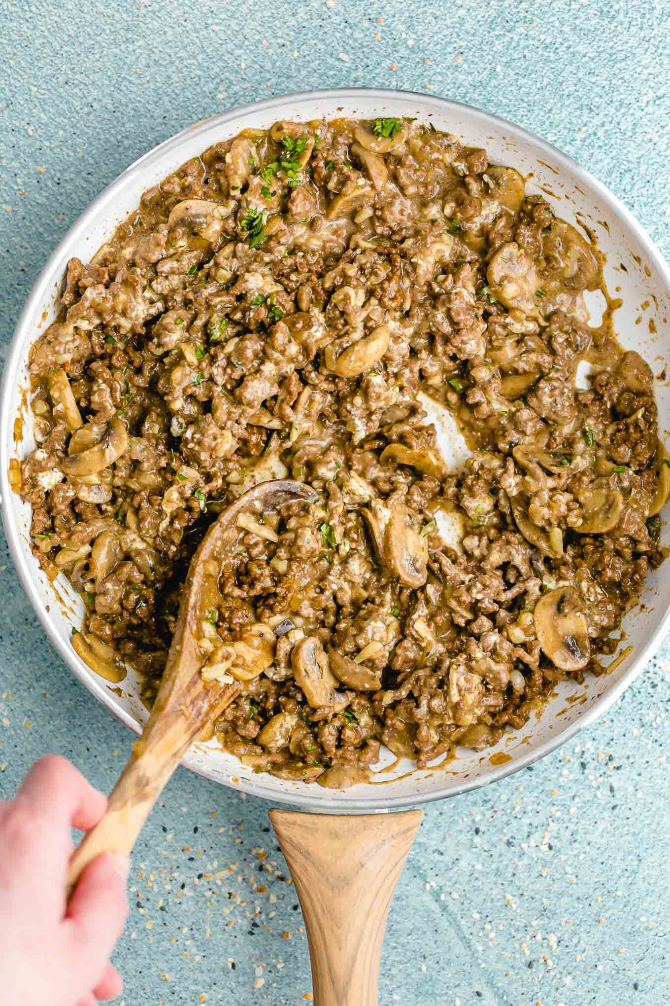 Creamy Cheeseburger Skillet with Mushrooms and Swiss! A deliciously creamy, cheesy, fully-loaded cheeseburger skillet that the whole family will love. Make it in just 30 minutes with ground beef, mushrooms, onions, cream cheese, and Swiss cheese.