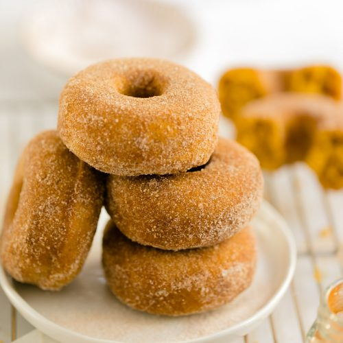 baked pumpkin donuts with cinnamon sugar coating