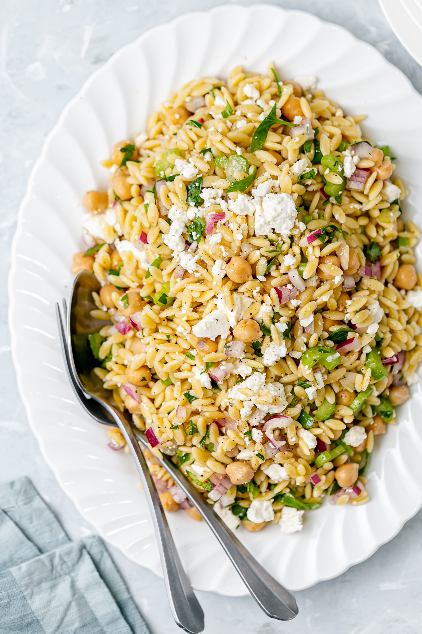 Minted Orzo Salad Recipe with Chickpeas and Feta Cheese - this deliciously easy vegetarian side dish is my most requested! It's loaded with fresh flavor from herbs and a bright lemon vinaigrette and it tastes amazing hot or cold so feel free to make ahead of time!